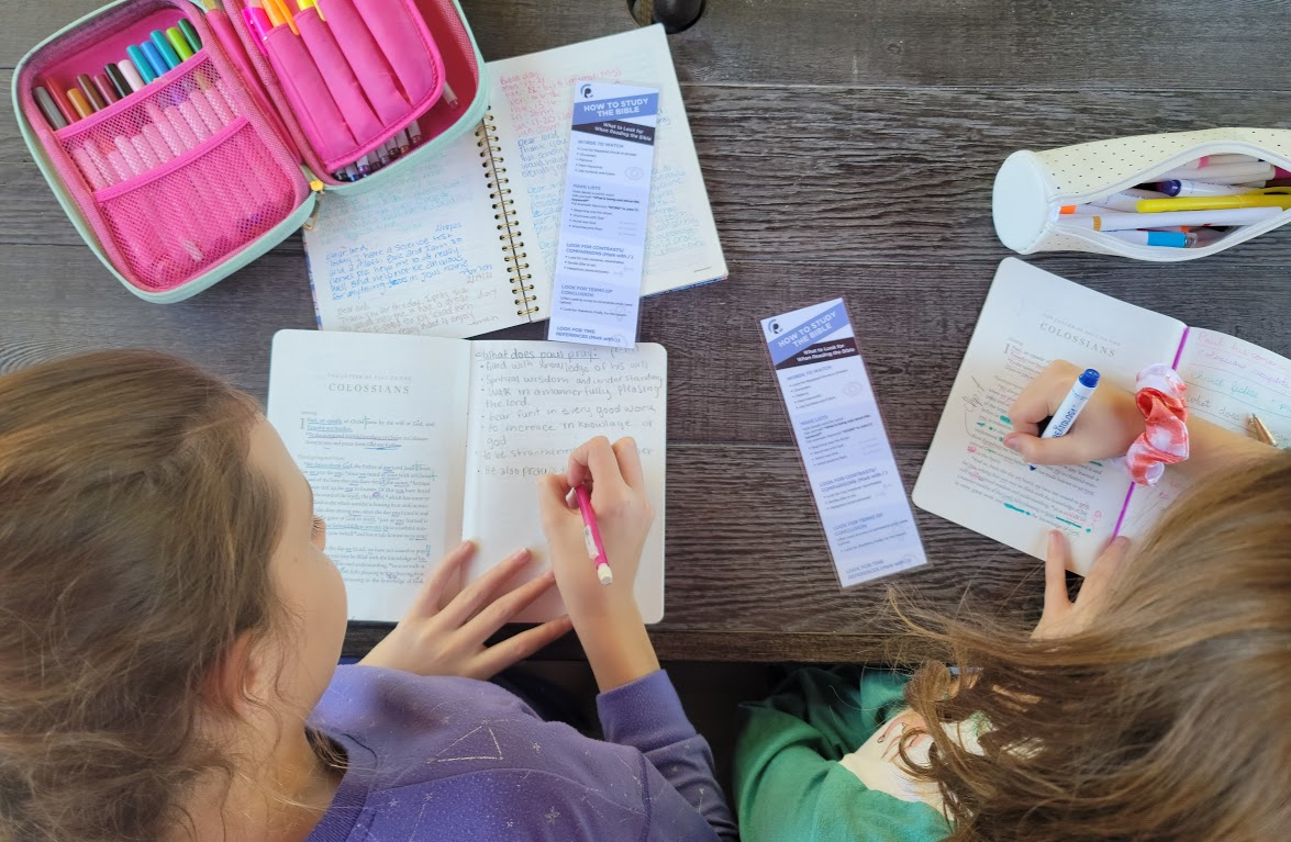 Girls studying the bible