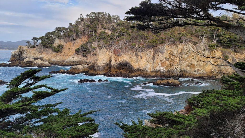 Point Lobos, rocks, blue water, white foam, green trees